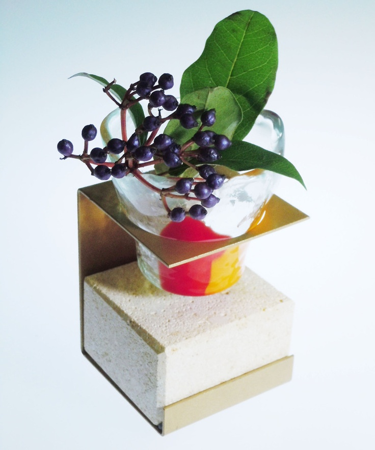Small glass bowl on a metal stand - can be used as a bud vase or a candle votive. By Glass Studio