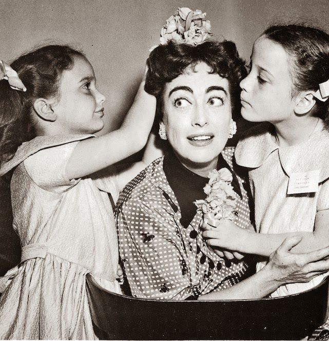 Joan Crawford with her twin daughters.