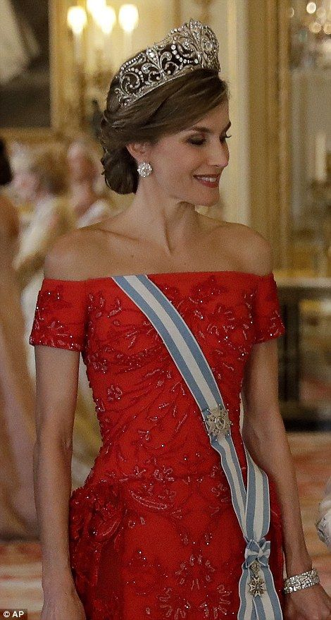 Queen Letizia plumped for her country's national colour and stunned in a bejewelled red go...
