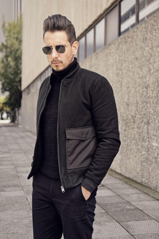 Bomber jacket with nylon side pockets + black turtle neck + black chinos