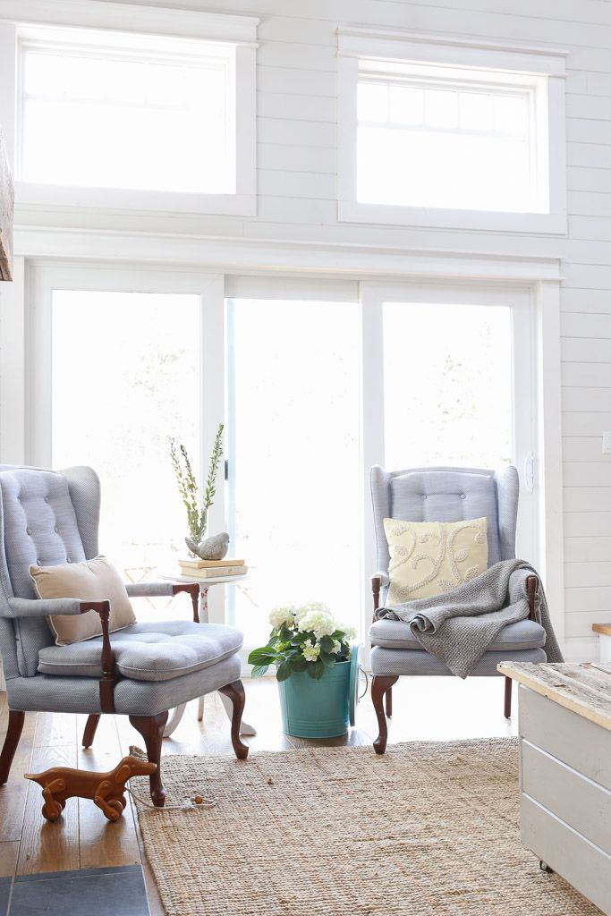 Coastal Farmhouse Style. Living room with grey shiplap and chunky white trim.