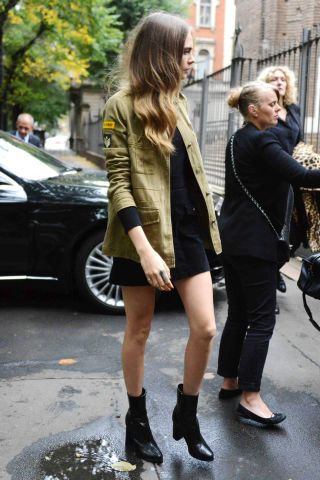 The utilitarian jacket is a new fall staple. Style it like Cara Delevingne over a black dress and matching booties.