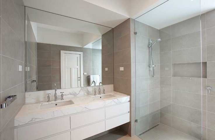 Grey tiles with marble bench top
