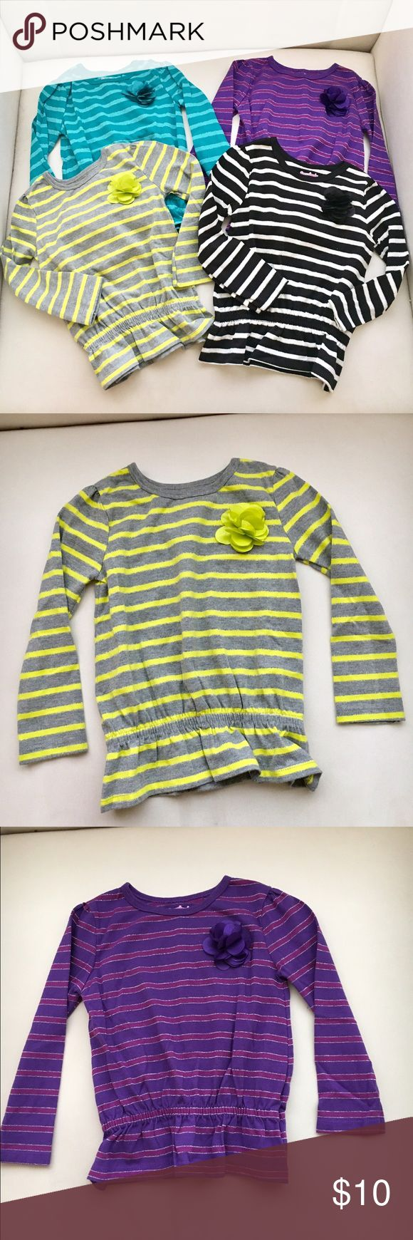 Lot of 4Little Girls Striped Long Sleeve Tops Lot of 4Little Girls Striped Long Sleeve Tops with elastic waist. Cute variety of long sleeve tops for your little girl.  Excellent condition, some never been worn. Pair it with jeans or some leggings! Great tops for all seasons!! Size 3T. Garanimals Shirts & Tops Tees - Short Sleeve