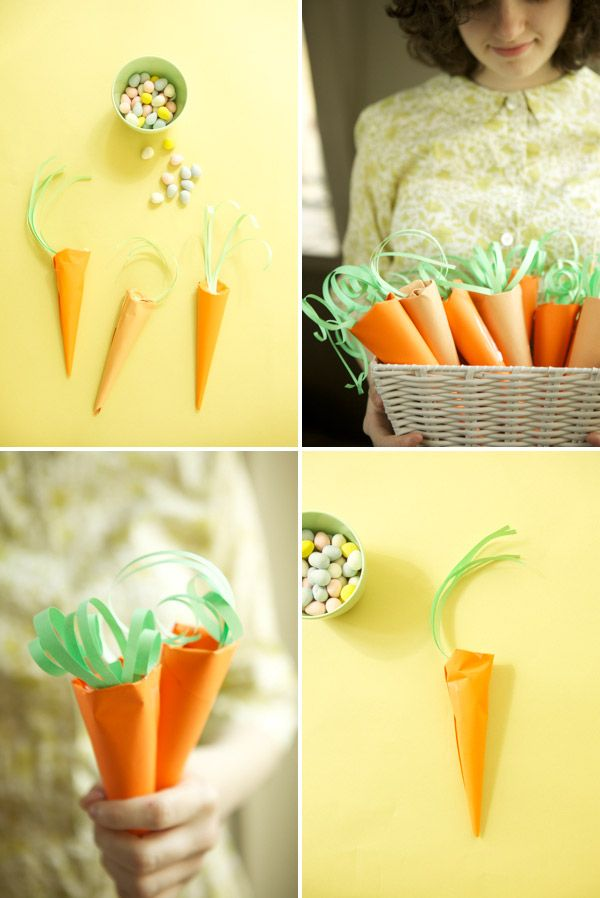 paper carrots filled with treats.