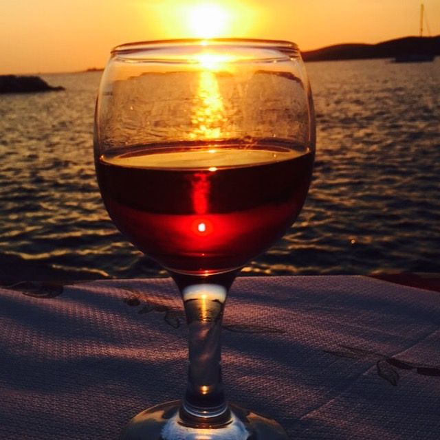 A glass of wine while watching the sunset.