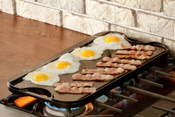 The best way to make breakfast for a family? A reversible cast iron griddle. Smooth on one side, grill ridges on the other. Made in the USA.