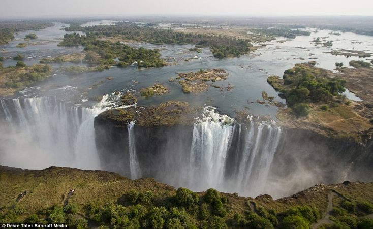 The mile-wide Victoria Falls - the largest waterfall in the world, which flows between the African nations of Zambia and Zimbabwe.