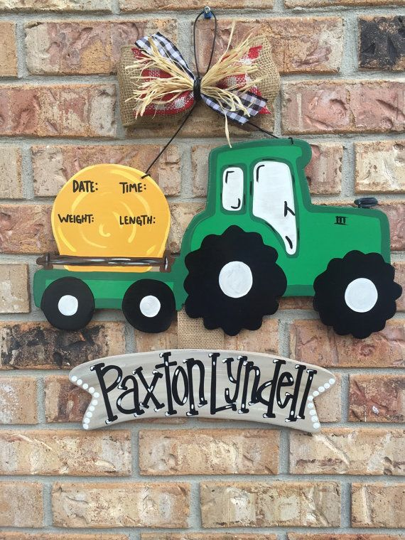 Baby oh baby!!! What better way to announce the newest addition than this sweet country boy tractor!!! These door hangers by ByeByeBirdie are perfect for gender reveals, yard signs or hospital door announcements. Every piece is hand painted and weather sealed so no two signs are exactly alike. Bow colors and materials are customizable along with paint colors. If I dont have the color we can make it!!! Optional name can be painted on, vinyled on, hung under or a chalk board piece can be…