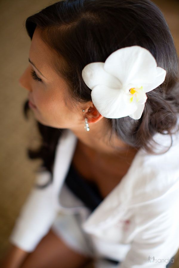 Hair down in soft curls, pinned back with an #orchid. Photo by Dmitri and Sandra Photography