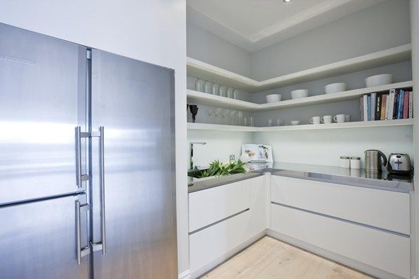 trendsideas.com: architecture, kitchen and bathroom design: Competitive edge - A scullery provides additional storage. The blonded French oak floors are by Freedom Flooring.