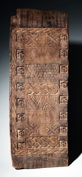 Africa | Palace or shrine door panel from the Yoruba people of Nigeria | Wood, dull brown patina | By Olowe of Ise or his workshop. Olowe of Ise, born in Efon Alaye, Southern Ekiti, is widely regarded both by the Yoruba of Ekiti and by Western students as the greatest Yoruba carver of the 20 century.