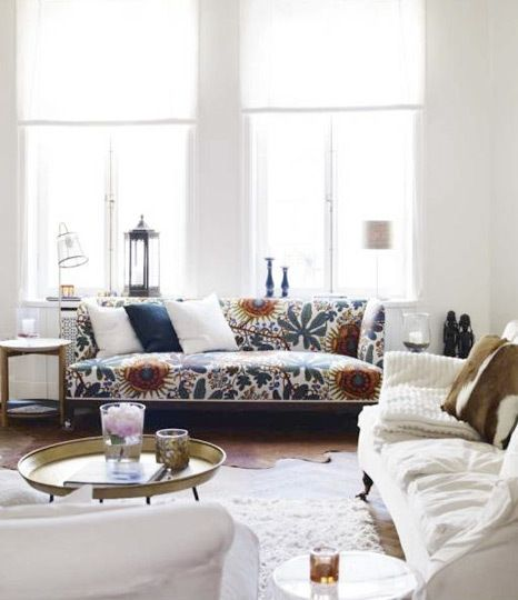 patterned sofa in an all white room