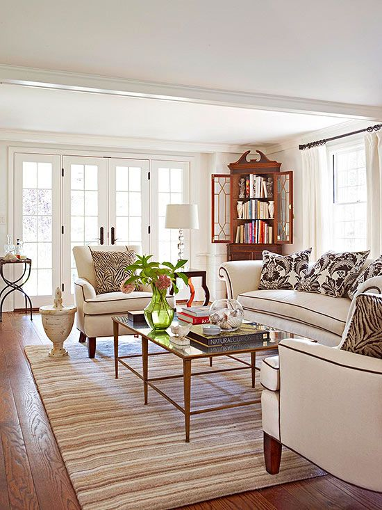 Incorporate light and dark contrasting details to boost a neutral living room's appeal.