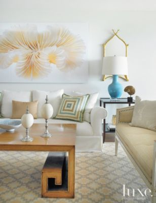 A #sculptural coffee table centers a #waterfront Key Biscayne #condo's #livingroom. | See MORE at www.luxesource.com. | #luxemag #interiordesign #design #interiors #homedecor