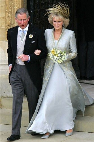 On April 9, 2005 Camilla Parker Bowles, the longtime mistress of Charles, Prince of Wales were married at Windsor Guildhall. It was the second wedding for both. Camilla wore an outfit designed by Robinson Valentine. Charles's parents could not attend the marriage ceremony as the Queen was unable to attend the remarriage of a divorcee, due to her position as Supreme Governor of the Church of England.