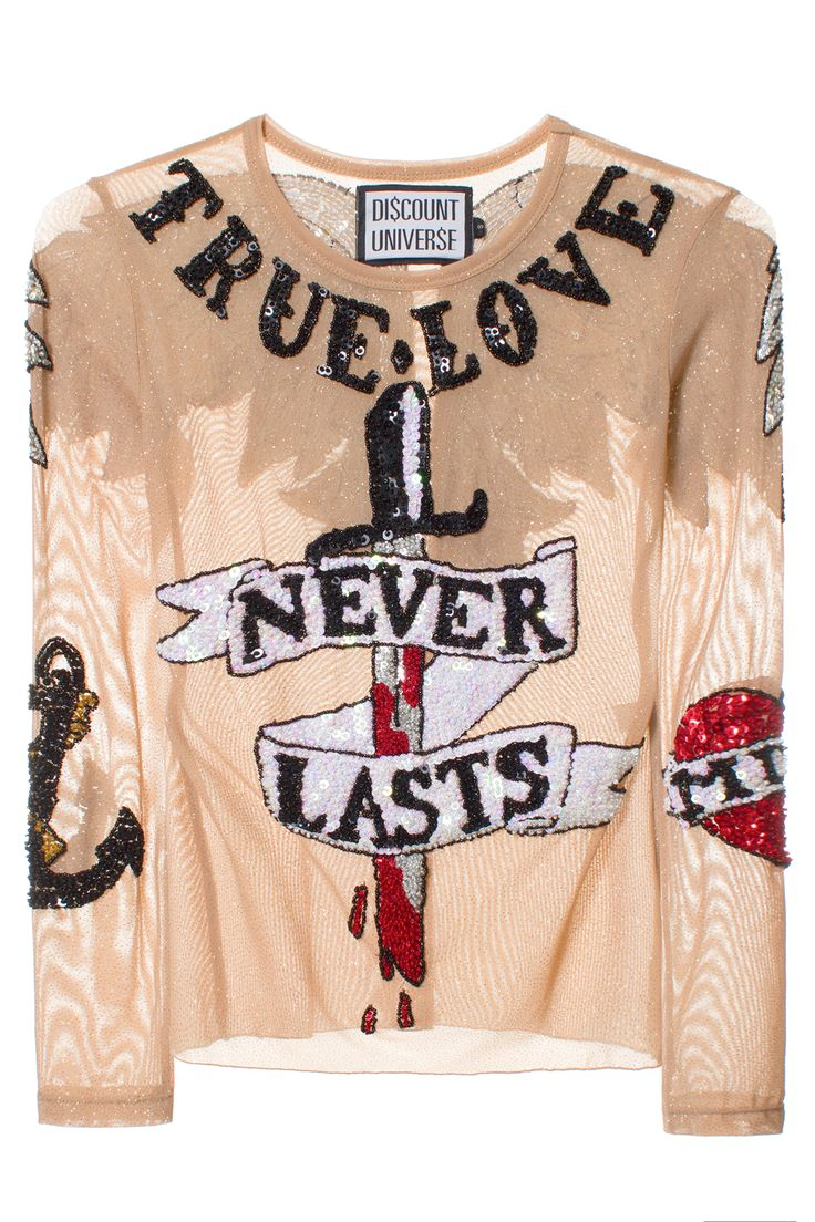 DISCOUNT UNIVERSE TRUE LOVE NEVER LASTS SEQUIN L/S Mesh shirt with sequin embroidery. Made in Indonesia. 70% Spandex 30% Polyester. SIZE & FIT Fits true to size. DISCOUNT UNIVERSE Discount Universe is a Melbourne-based label from Aussie duo Cami James and Nadia Napreychikov. Their bright, hand-embellished pieces that pack a punch with sequins, gems, and cartoon-like graphics have won them legions of loyal fans. A VFILES THIRD FLOOR showroom designer and VFILES RUNWAY F/W 2015 winner!