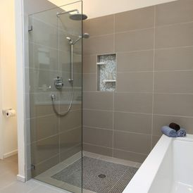 Midcentury Bathroom by ID by Gwen  Love the glass panel and the shower floor - no ledge.