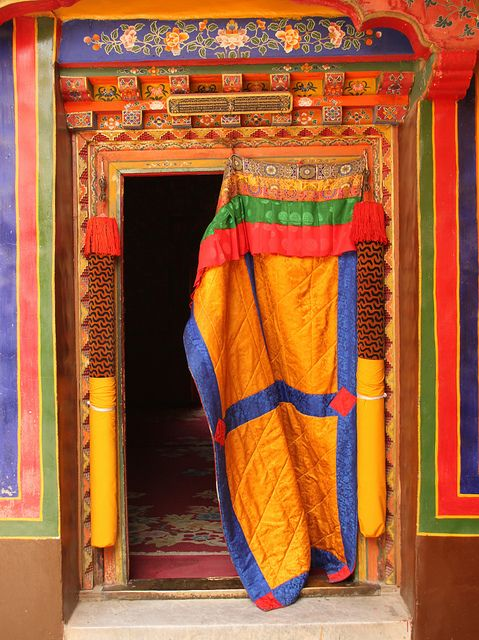 Ornate door in the Dalai Lamas old Summer Palace - Tibet, China