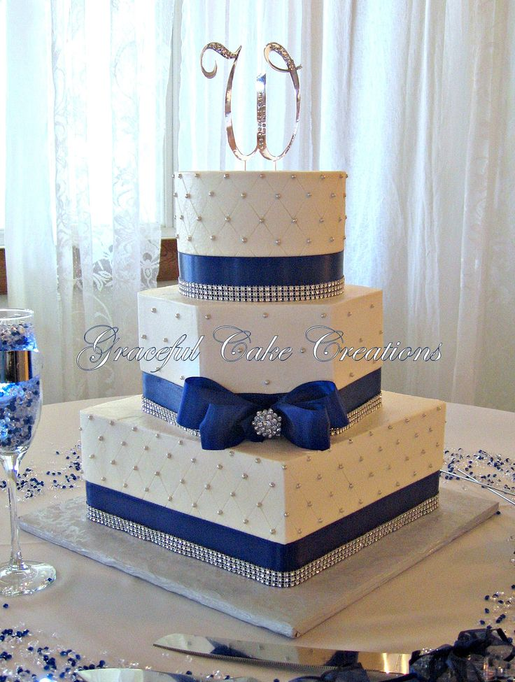 Elegant White Butter Cream Wedding Cake With Navy Blue And Bling Ribbon By Graceful Creations