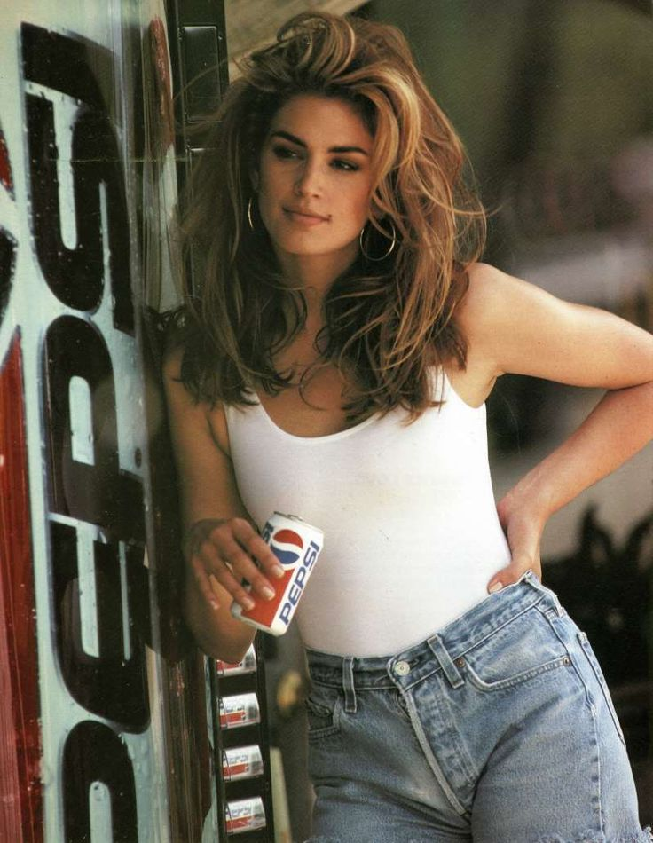 This image released by Pepsi shows actress-model Cindy Crawford in a scene from her 1992 iconic Super Bowl Pepsi commercial. Crawford returns for another Pepsi commercial which will premiere during Super Bowl LII on Feb. 4. The new ad includes her son, Presley Walker Gerber, as well as footage from Michael Jackson's memorable Pepsi commercial. (Pepsi via AP)