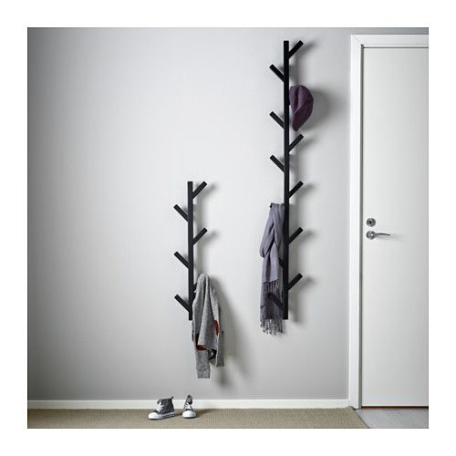 TJUSIG Hanger - black - IKEA TJUSIG Hanger, black $9.99 The price reflects selected options Article Number: 802.917.07 The hanger helps you transform an empty wall into a practical storage space for clothes, bags and shoes. Read more Size 30 ¾ ""