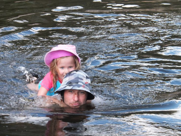 A  swim in the river with Dad is great fun