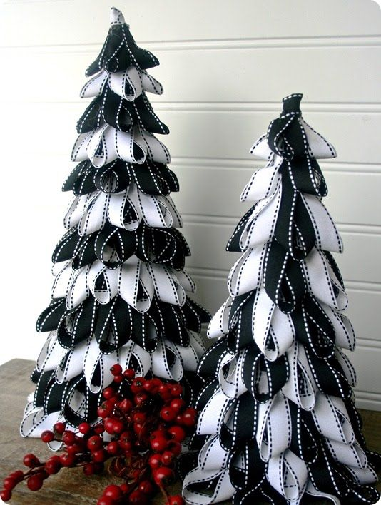 Ribbon Trees - could be done with paper. Would be cool with strips of white paper (or vellum) cut with decorative scissors and then accented with pin-punched designs. Put tree cone over battery operated light