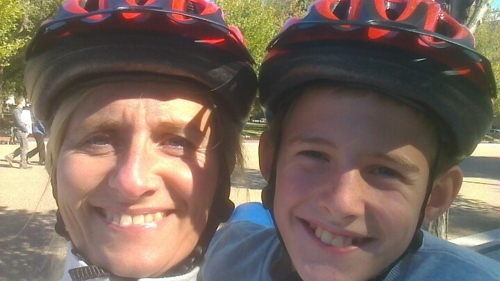 Mom and son off course wearing Capital Bikeshare helmets when biking in Washington DC