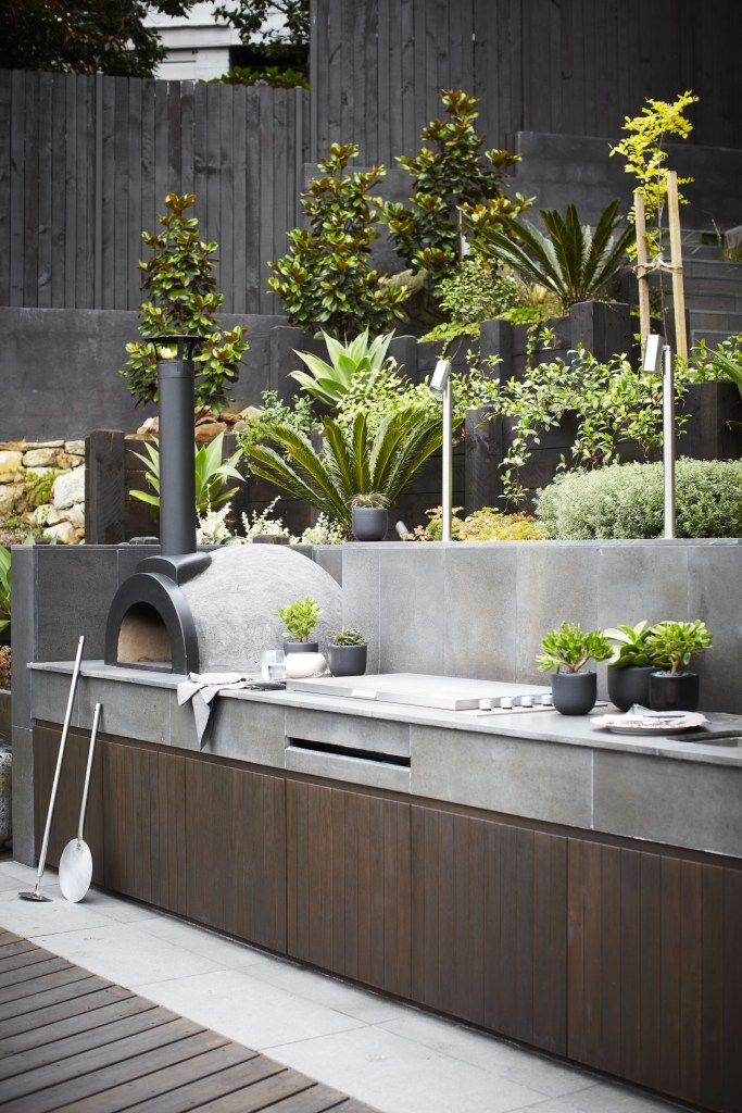 in love with this built in grill surrounded by planter boxes and do i see a pizza stove find this pin and more on outdoor kitchen ideas - Outdoor Planter Wall Kitchen Designs