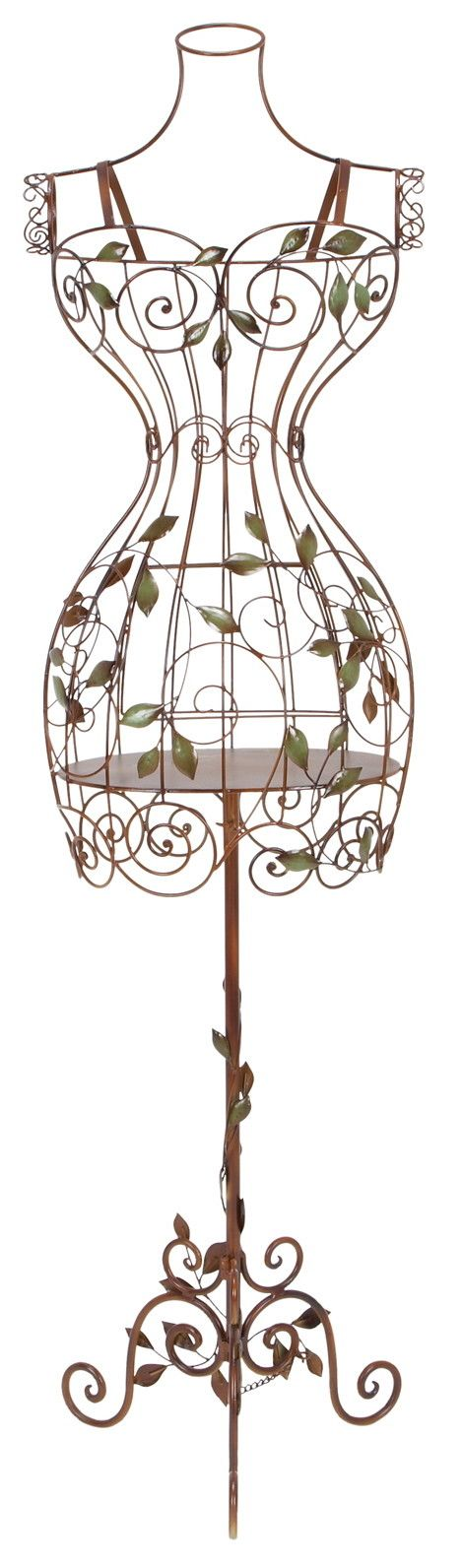 Features:  -Adds elegance with iron scroll designs.  -Color: Reddish-brown.  -Does stand on its own.  Product Type: -Sculpture.  Style (Old): -Traditional/French.  Subject: -Home decor and furniture.