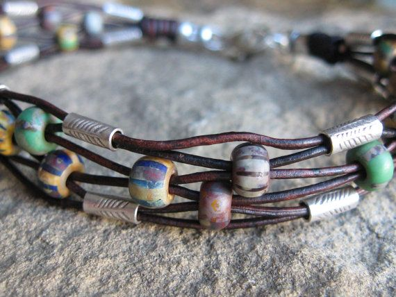 Rustic 6-strand leather bracelet with Czech glass beads and Hill Tribes silver tubes.  Pretty woven effect.  . . .  ღTrish W ~ http://www.pinterest.com/trishw/  . . .   #handmade #jewelry #beading