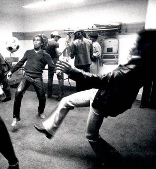 Bob Marley and Jimi Hendrix having a kickabout
