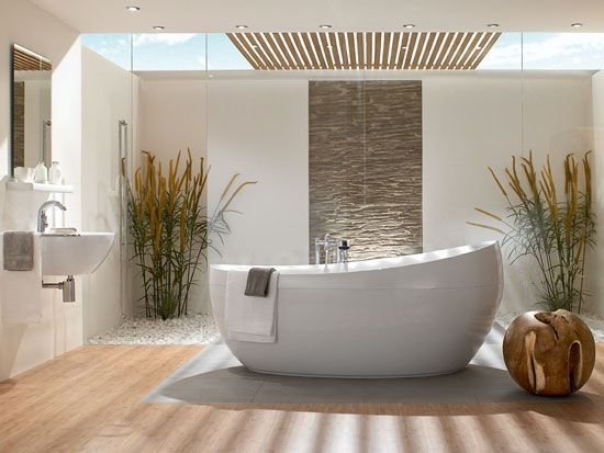 Natuurlijke materialen en warme kleuren gecombineerd met rustige vormgeving zorgen voor een ontspannen, zen-achtige badkamer. #zen #badkamer