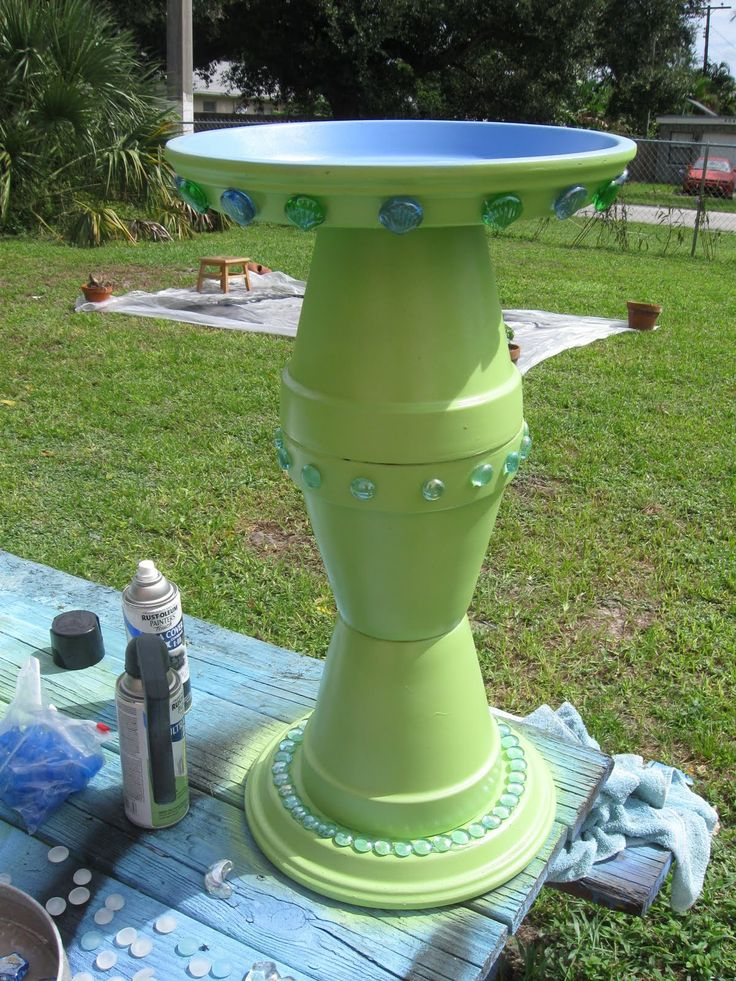 Stacked terracotta flower pots repurposed and upcycled as DIY bird bath