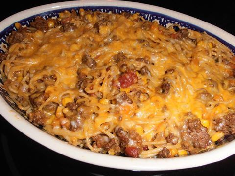 Mexican Spaghetti  6 oz. thin spaghetti 1 lb. ground beef 1 small onion, chopped 1/2 bell pepper, chopped (I only had orange but any would work) 1 small can of whole kernel corn, drained 1 pkg. taco seasoning 3/4 C. water 1/2 C. salsa, I used a little more 1 1/2 C. shredded Colby jack cheese  Bring a pot of water to a boil and cook spaghetti according to pkg. directions. Meanwhile, brown ground beef in a large skillet, drain grease and add in the onion and peppers. Cook till onion becomes…