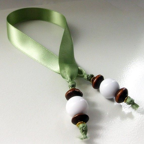 A silky sage ribbon with satin sheen makes up the body of this simple, elegant bookmark with dark wooden beads, gold plated metal beads and large white rounds at the ends.  Our bookmarks are sure to mark your place with your own personal style without damaging books pages by the commonly used corner-folding methods. These ribbon bookmarks are my gentlest bookmarks yet!  I use my own bookmarks not just in books Im reading but also in my date book and journal to make it easy to turn to the…