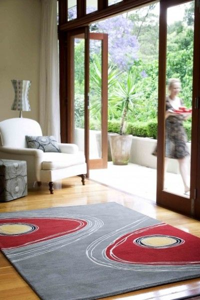 Aboriginal designer inspired floor rug in 100% wool. The red and grey tones create a dramatic impression.