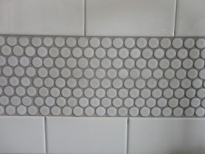 white subway and penny tile light gray grout
