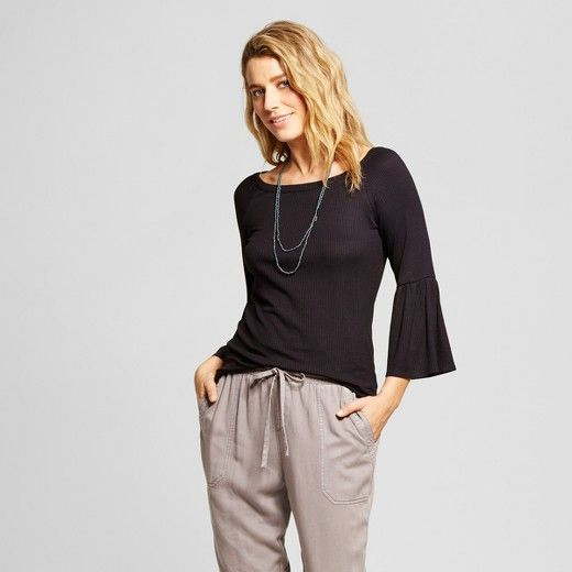 For a timeless, versatile addition to your closet, pick up the Boatneck Long Bell-Sleeve Knit Top from LORAMENDI. Made from soft fabric with added spandex so it moves with you, this long-sleeve knit top offers both comfort and style, whether you pair it with jeans for a casual outfit or a long, flowy skirt to complete your boho-chic look.