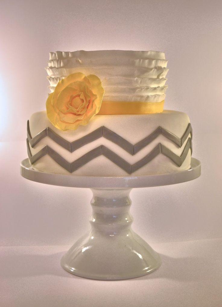 Chevron and ruffle cake. Yellow, grey and white wedding cake.