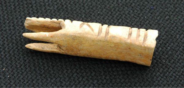 Possible bone lucet from Farm 12. About 6 cm long. Find from Örja, Landskrona (Skåne), Sweden.