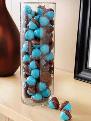 Painted Acorns  What you'll need: acorns, acrylic paint (white, blue, and brown), paintbrush, Satin Mod Podge    Make it: To make sure your colors really pop, paint the entire acorn with a base coat of white paint. Once dry, paint the bottoms with a bright color, like this teal, and paint the tops of the acorns brown. Seal your project with Mod Podge and display them in a glass container.