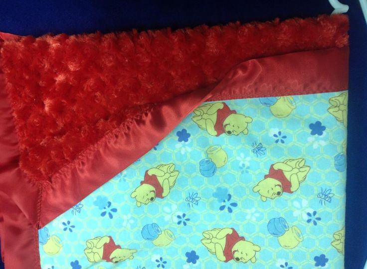 whinnie the pooh blanket with red rose and red trim. 36x36""