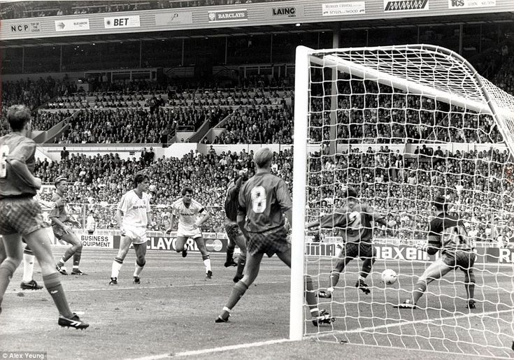 Bryan Robson (in white, centre) watches as his effort finds the net via a deflection off John Pemberton's shin for 1-1