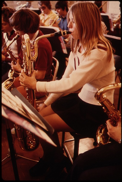 Students at band practice at Cathedral High School in New Ulm, Minnesota. The town is a county seat trading center of 13,000 in a farming area of South Central Minnesota. National Archives, DOCUMERICA (David Stroble) ARC 558221