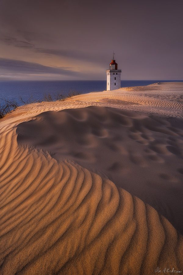 ~~Rubjerg Knot Lighthouse | lighthouse resides on sea dunes along the northwest coast of Denmark. Due to sea erosion it is predicted that the lighthouse will be swallowed by the sea circa 2013 | by Ole A. Endresen~~