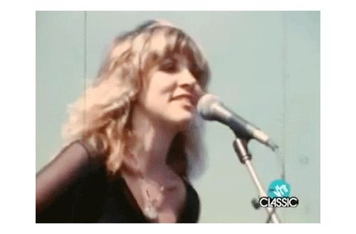 """Stevie singing her iconic song """"Rhiannon' onstage outdoors, 1976, just after she joined Fleetwood Mac in 1975   ♥♫♥❤♥♫♥ https://en.wikipedia.org/wiki/Stevie_Nicks"""