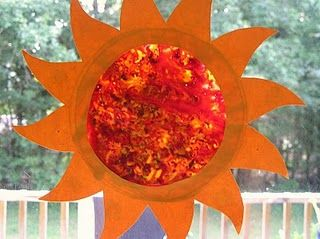 Sun Art - wax paper, crayon shavings melt in the window with the sun!