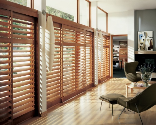 wood shutters for large windows in the living room